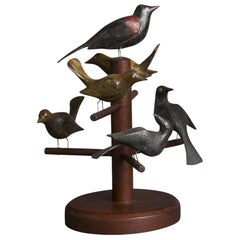 Six Carved and Polychrome-Decorated Pine Birds Mounted on a Tree