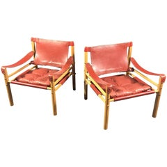 Pair of Arne Norell Red or Orange Leather Sirocco Chairs, Sweden