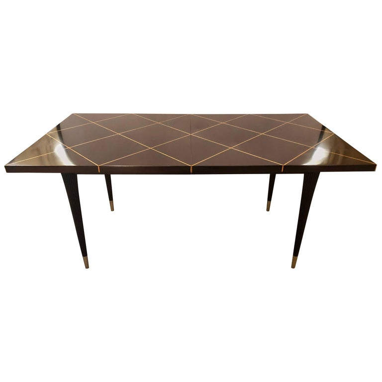 Mid-Century Modern Tommi Parzinger Tagged Dining Table with Two Leaves
