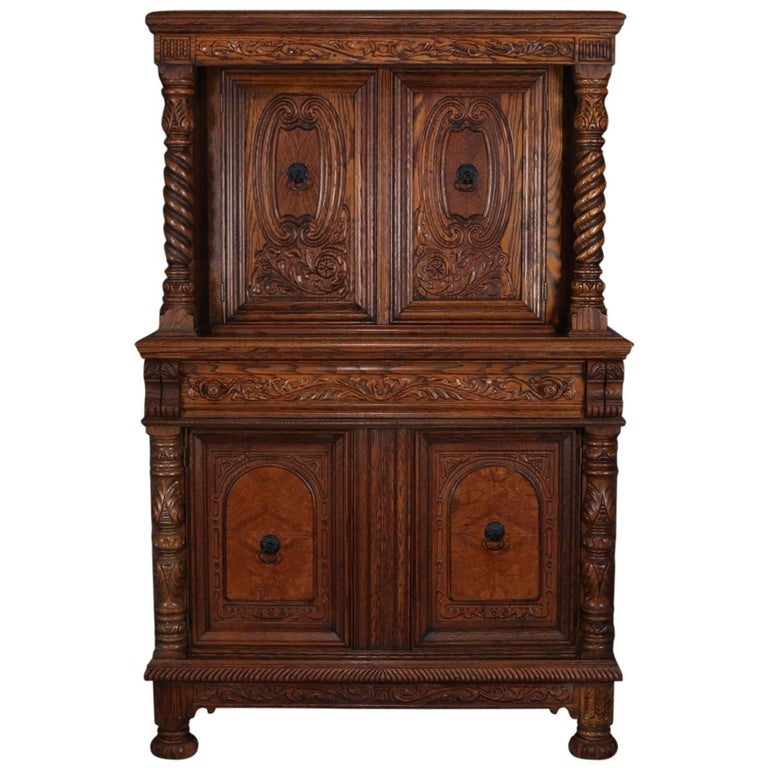 Antique Jacobean Heavily Carved Oak and Burl Step Back Cupboard, circa 1930  For Sale - Antique Jacobean Heavily Carved Oak And Burl Step Back Cupboard