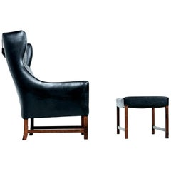 Fredrik Kayser Black Leather and Rosewood Wingback Lounge Chair and Ottoman