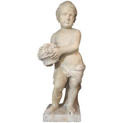 19th Century Italian Stone Sculpture of a Putto Holding a Basket with Flowers