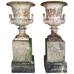 Pair of 19th Century Cast Iron Urns on Terracotta Stands