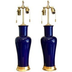 Pair of Cobalt Blue Porcelain Lamps on 23-Karat Water Gilt Wood Bases