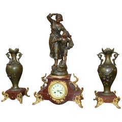 Late 19th Century French Imitation Bronze Spelter and Marble Clock Garniture Set