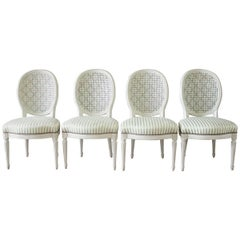 Set of Four Louis XVI Style French Painted Cane Back Dining Chairs