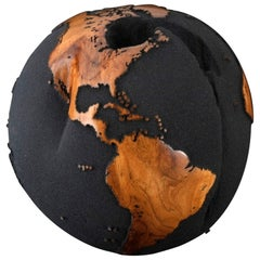 Contemporary Globe in Teak Root with Volcanic Sand and Natural Holes