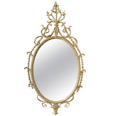 Giltwood and Carton-Pierre Robert Adam Period 'Dressed' Oval Looking-Glass