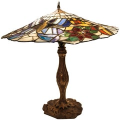 Tiffany Style circa 1900 Table Lamp in Polychromed Leaded Glass and Bronze