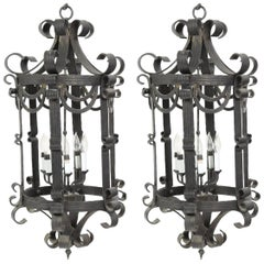 Pair of Large Hand-Forged Six-Light Iron Scrolled Lanterns