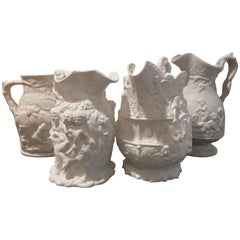 19th Century Lot of Four Porcelain Relief Pitchers