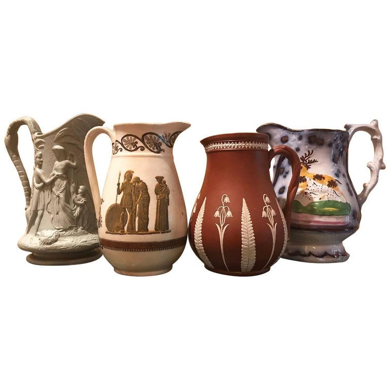 Mid-19th Century Lot of Four Porcelain Relief Pitchers