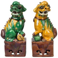 Chinese Pair of Yellow and Green Foo Dogs