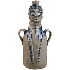 Stoneware Figural Jug, Man in a Cutaway Coat