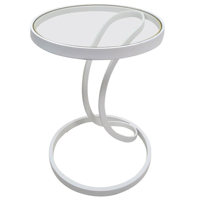 Cantilevered Metal and Glass Stand