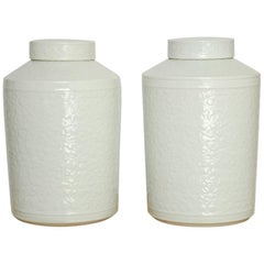 Pair of Chinese Floral Blanc de Chine Lidded Jars