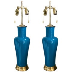 Pair of Vibrant Teal Porcelain Lamps on 23-Karat Water Giltwood Bases