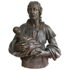A Sculpture Oak Bust of the Christ Holding a Child, Austria, 18th Century