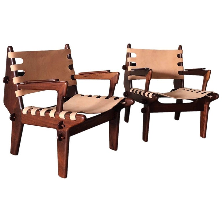 Pair of Angel Pazmiño Sling Armchairs and one Ottoman