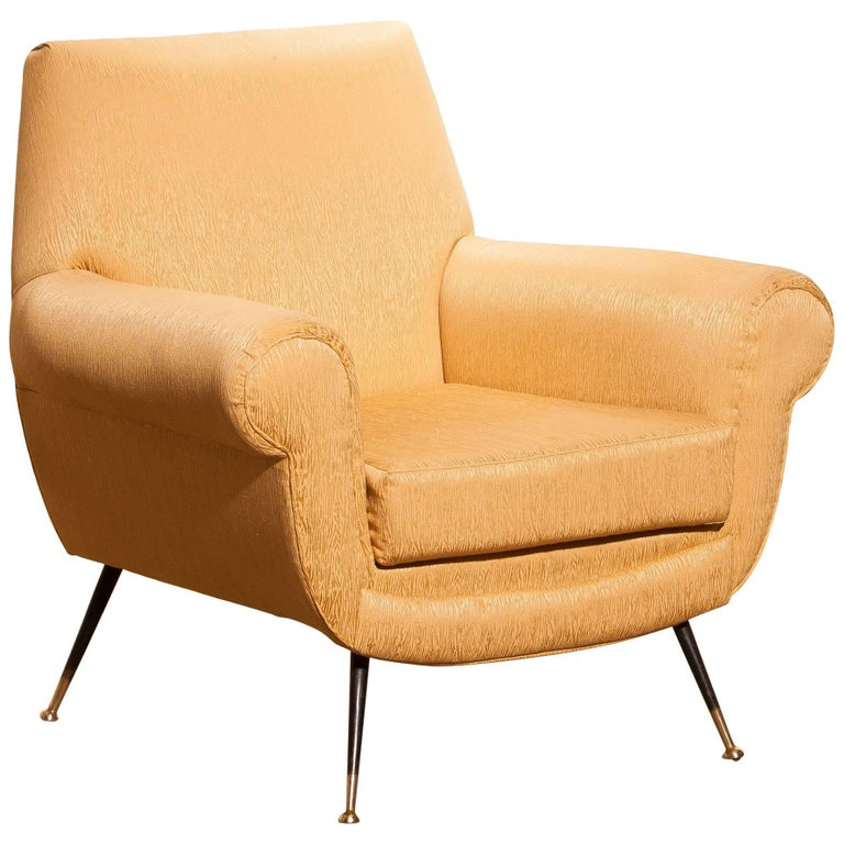 Gigi Radice for Minotti Easy Chair in Gold Colored Jacquard And Slim Brass Legs. For Sale