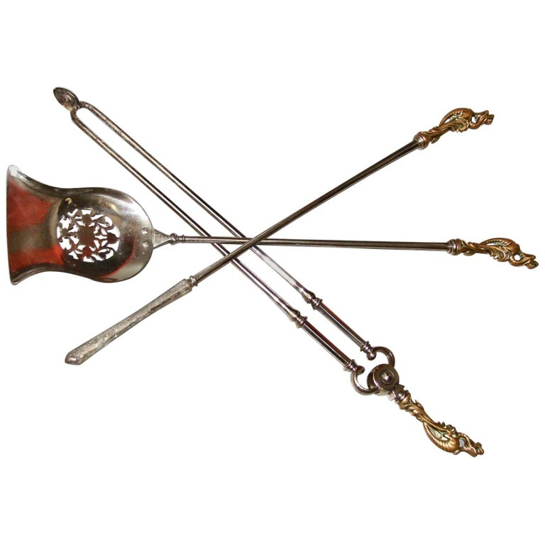 Set of Three English Bronze and Polished Steel Fire Tools with Dragon Handles For Sale
