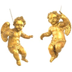 Pair of Italian Rococo Style '18th Century' Winged Lifesize Hanging Cupids