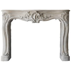 Antique French Limestone Fireplace of the 18th Century, Style of Louis XV