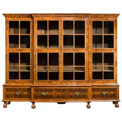 Walnut and Oyster Veneered Breakfront Four-Door Bookcase, England, 1920