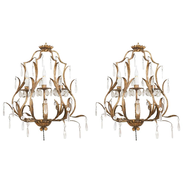 Pair of Sconces in Gold gilt metal with crystals, 1950-1960, Three lights