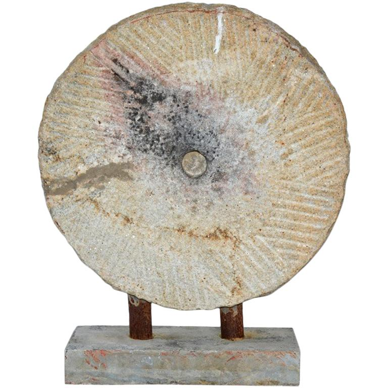 Mill Stone Mounted Sculpture