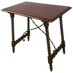 Spanish Baroque Side Table with Iron Stretcher and Carved Top in Walnut