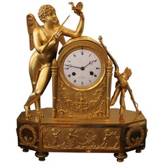 An Early 19th Century Cupidon Gilt Bronze Clock