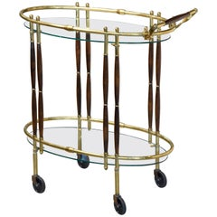 Sleek Mid-Century Modern Brass, Walnut and Glass Oval Bar Cart
