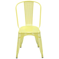 A Chair Perforated in Pastel Yellow by Xavier Pauchard & Tolix