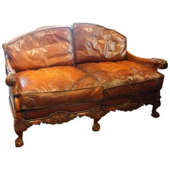 Edwardian Walnut and Leather Bergere Sofa