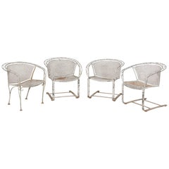 Set of Four White Painted Metal Garden Dining Chairs with Heavy Patina