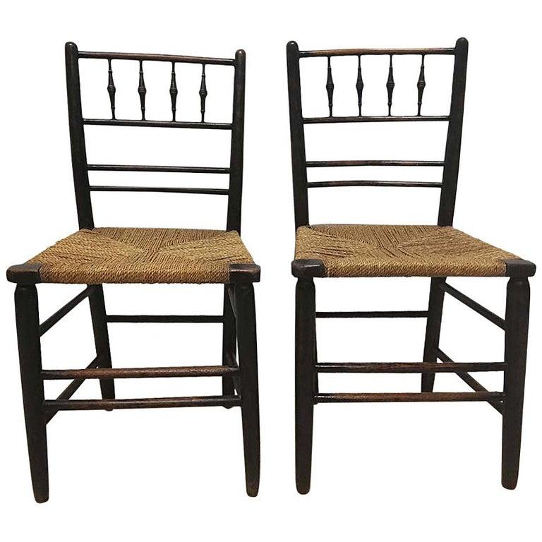 William Morris, Three Ebonized Rush Seat Sussex Side Chairs