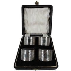 Set of Four English Art Deco Sterling Silver Napkin Rings in Leather Box