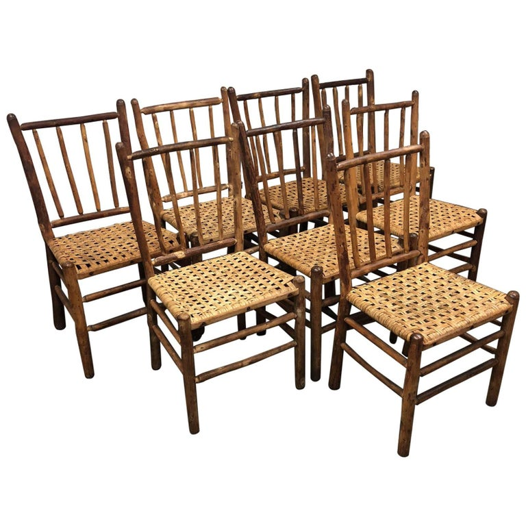 Set of Eight Rustic Dining Chairs Wood and Caning