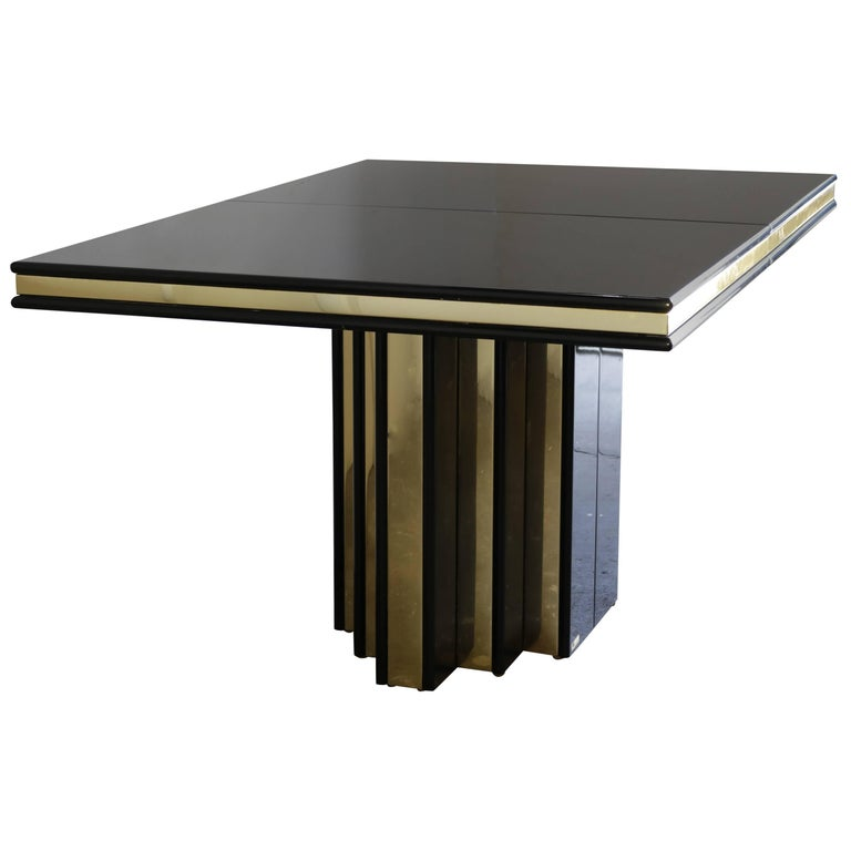 This table is made of black lacquer with brass inlays. Two leaves allow extending of 16