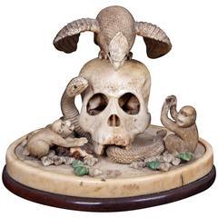 Okimono of a Skull with a Snake, Hawk and Monkeys, circa 1890