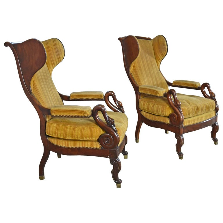 Pair of 19th Century French Empire Mahogany Wing-Back Armchairs For Sale