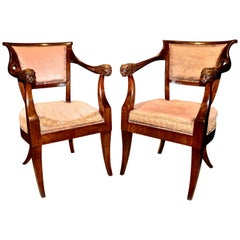 Pair of Period Russian or Austrian Neoclassical Walnut Chairs with Lion Motif