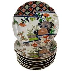 Japanese Imari Enameled Porcelain Floral and Geometric Plates, Set of Eight