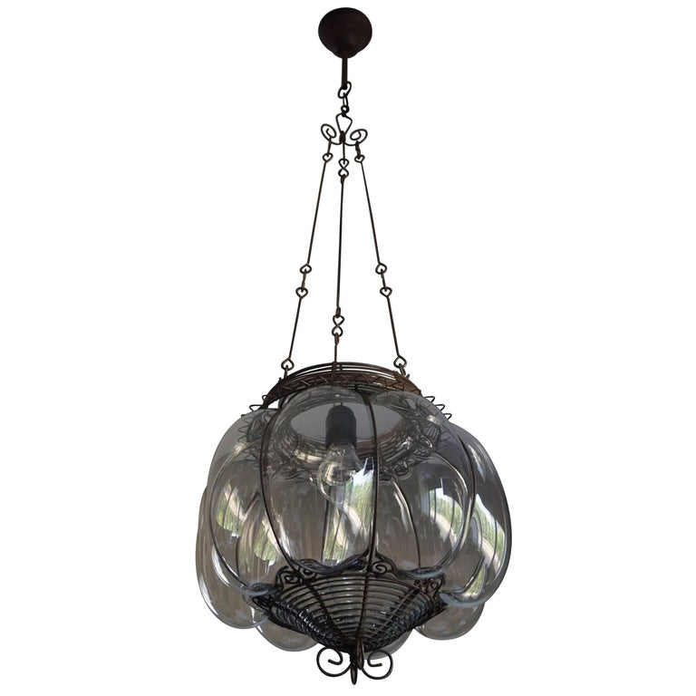 Venetian Mouth Blown Glass into a Handcrafted Iron Frame Pendant Light Fixture