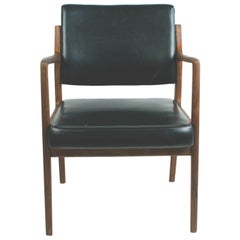 Scandinavian Modern Teak and Black Leatherette Armchair by K. E. Ekselius