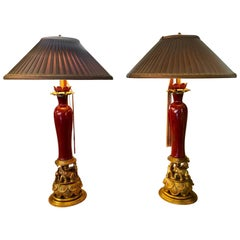 Tole Metal & Red Glaze Table Lamps on Gilt Elephant Bases Signed F. Cooper, Pair