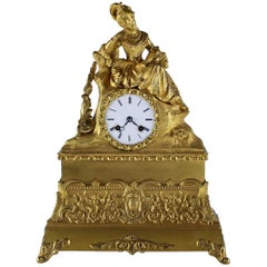 French Ormolu Clock, circa 1860 Depicting a Lady in Court Dress Reading a Book