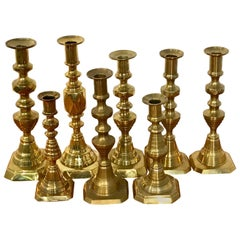 Collection of Eight Antique English Brass Candlesticks