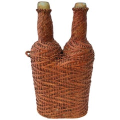 French Hand Blown Bottles Surrounded by Woven Wicker with Detached Handle, Pair